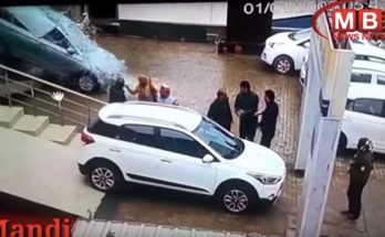 Women Crashes Hyundai Out of the Dealership Window 10