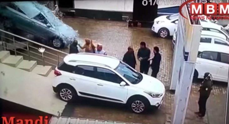 Women Crashes Hyundai Out of the Dealership Window 1