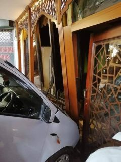 Female Driver Crashes Her Car Into a Restaurant 4